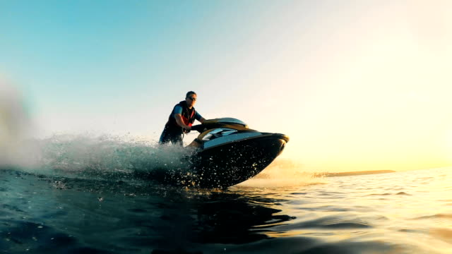Jet boating process of a waterbike with a man managing it Jet-skiing process of a waterbike with a man managing it. HD recreational boat stock videos & royalty-free footage