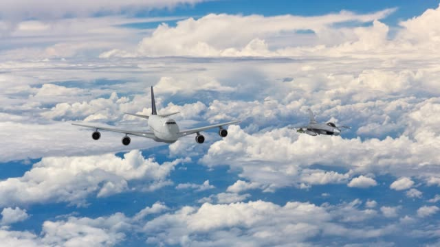 Jet fighters escorting a commercial airplane