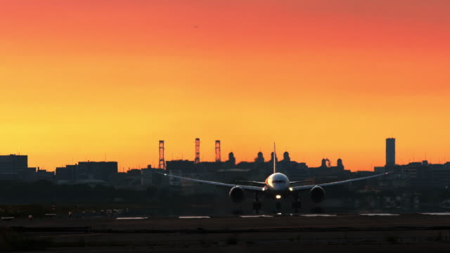 Jet plane depart from airport in sunset
