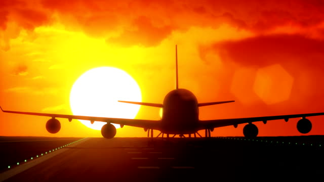 Jet plane departs from airport runway with big sun