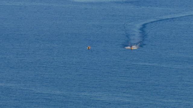 Jet ski on blue surface of sea video