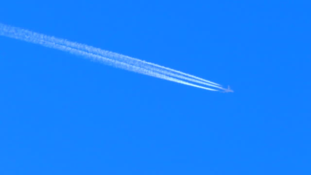 Jet Streaking Across Blue Sky, Perfectly Stable 4K Footage, Contrail video