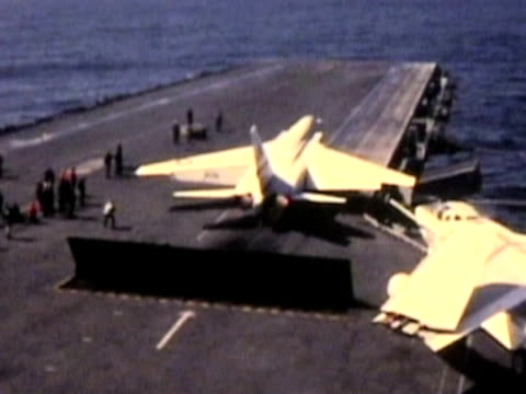 Jet takeoff from aircraft carrier-From 1960's movie film video
