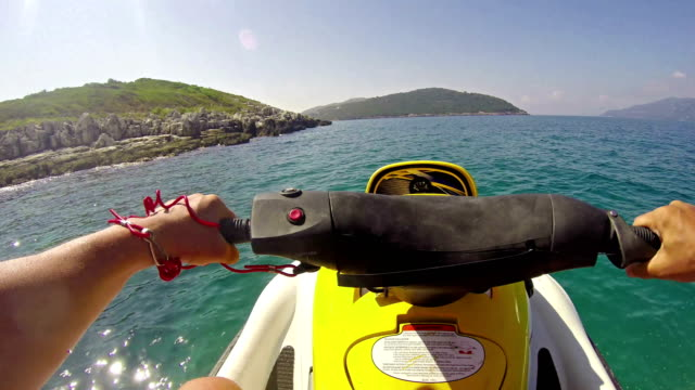 jetski sport race pov on circa august in corfu, greece. tourism and recreation is main source of income to corfu island. beautiful clear green water. - adrenalina video stock e b–roll
