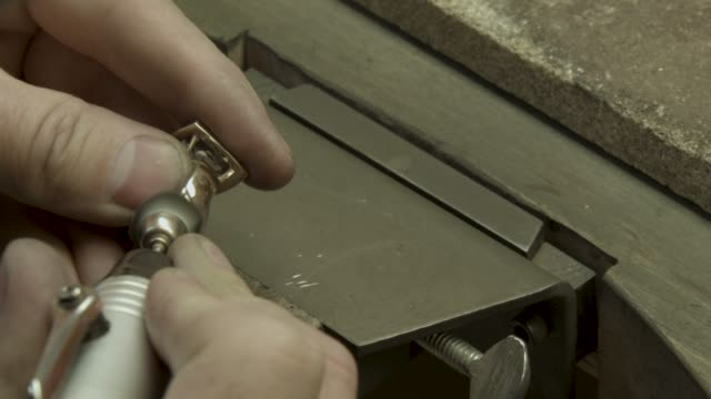 Jeweler cleans a diamonds ring with a polishing wheel brush video