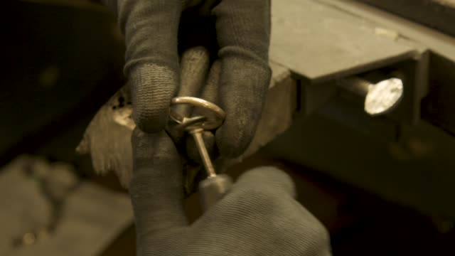 Jeweler cleans golden wedding ring video