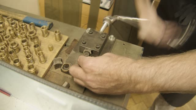 Jeweller creating a gold ring with a Bending machine video