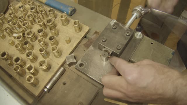 jeweller uses a Bending machine to create a gold ring, close up video