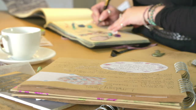 Jewelry Designer Writing Down Ideas And Materials In Book video