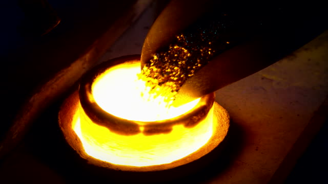 Jewelry manufacturing - smelting scrap gold in foundry Smelting scrap gold in blacksmith workshop blacksmith shop stock videos & royalty-free footage