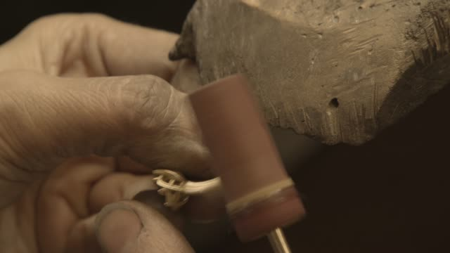 Jewelry Work. Polished Grinding Gold Ring. video