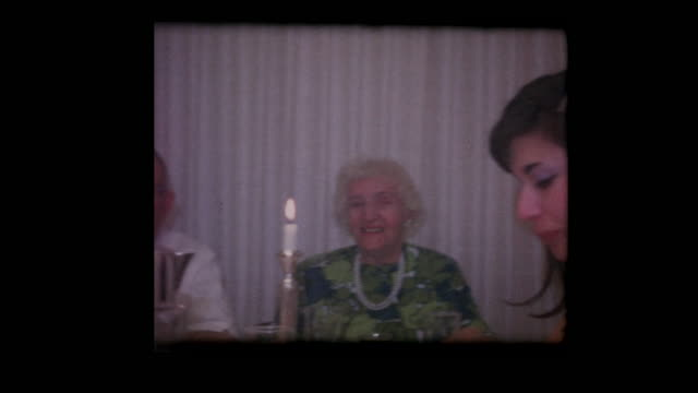 1964 Jewish family eats at Passover table for seder video