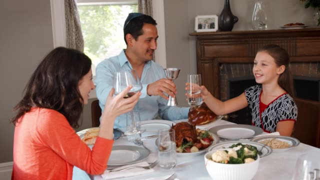 Jewish family making a toast before their Shabbat meal video