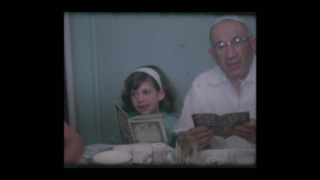 1961 Jewish family reads Haggadah at Passover Seder video