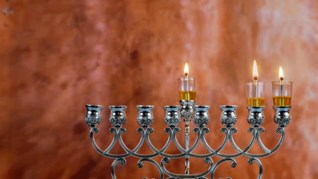 Jewish holiday hannukah symbols - menorah. Copy space background.