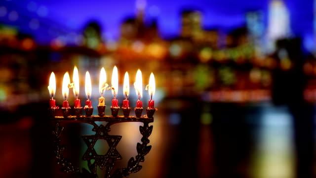 ユダヤ人の休日 hannukah シンボル - 本枝の燭台。ハヌカのろうそく、ユダヤ人 - ハヌカー祭点の映像素材/bロール