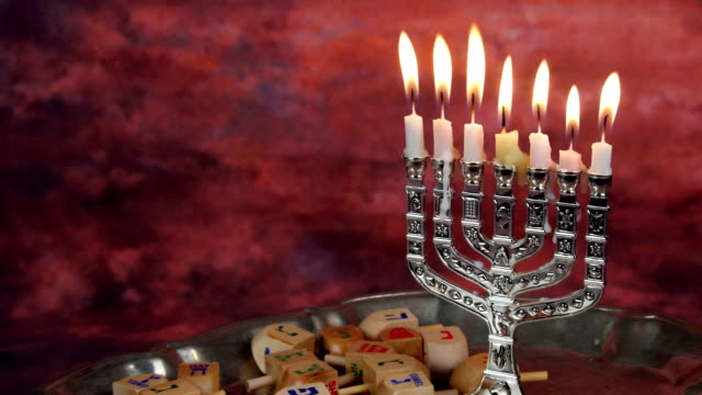 Jewish holiday Hanukkah creative background with menorah. View from above focus on video