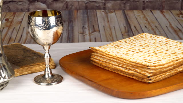 Jewish holiday Pesah celebration concept jewish Passover holiday Passover matzah Silver kiddush wine cup for passover, selective focus video