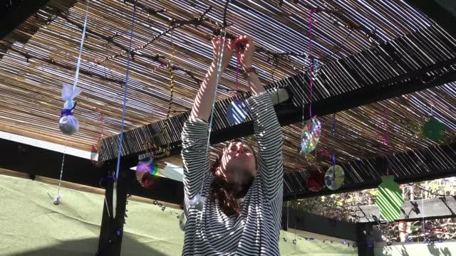 Jewish woman decorating Sukkah for Jewish festival Sukkot video