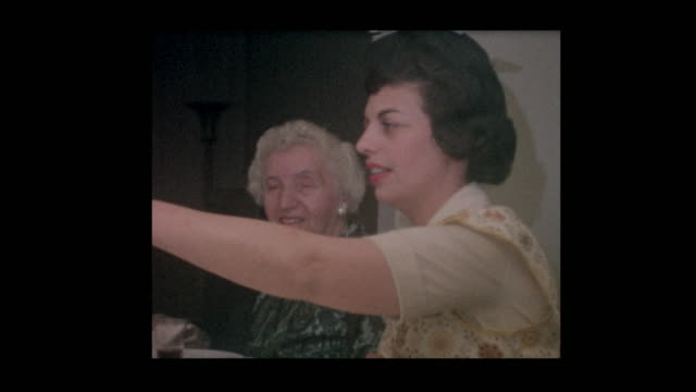 1964 Jewish woman light candles at Passover seder video