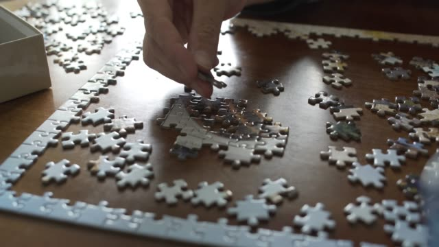 jigsaw table - puzzle video stock e b–roll