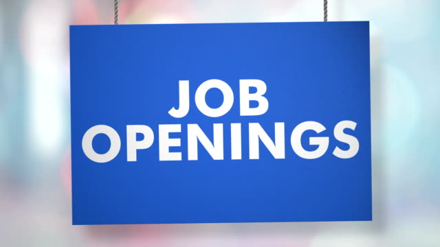 Job openings hiring sign hanging from ropes. Luma matte included so you can put your own background. video