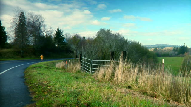 Jogger Country Road Dolly Left Wide Shot HD video