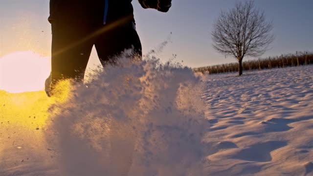 SLO MO Jogger Trudging Through The Snow video