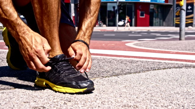 SLO MO Jogger tying his shoes video
