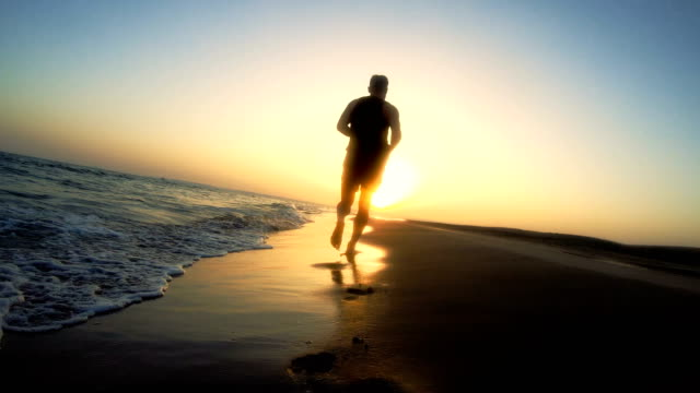 Jogging after sunset. Beach holiday