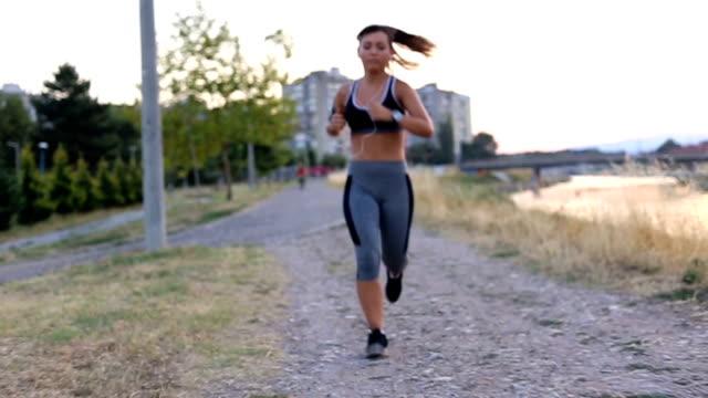 Jogging at summer sunset video
