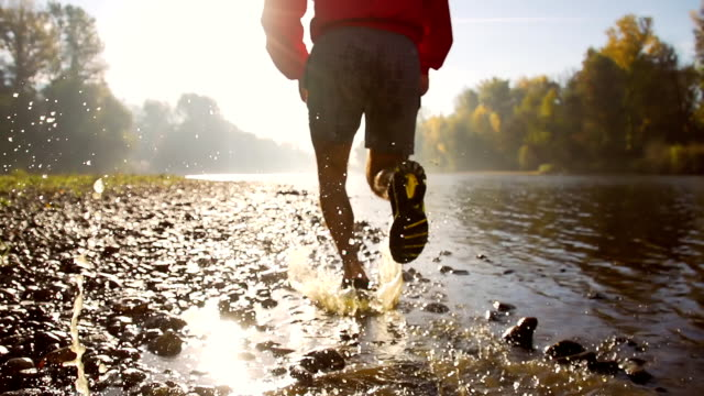 HD SUPER SLOW-MO: Jogging By The River video