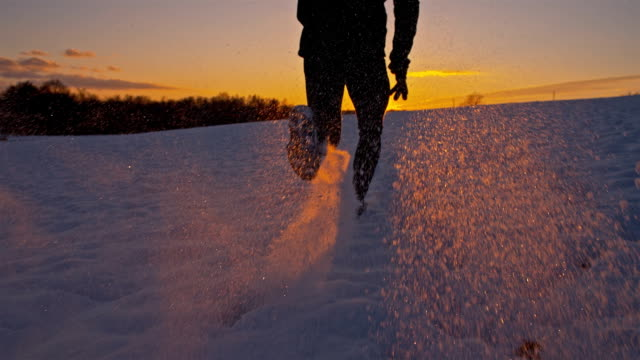 SLO MO Jogging In The Snow At Sunset video