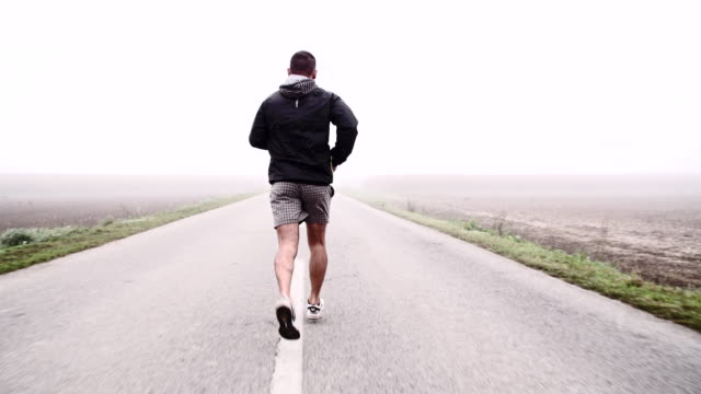 SLO MO Jogging On A Country Road video