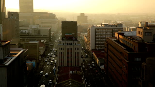 Johannesburg City Dawn A medium wide shot looking down into the streets of Johannesburg city centre on a cold winter's dawn. south africa stock videos & royalty-free footage