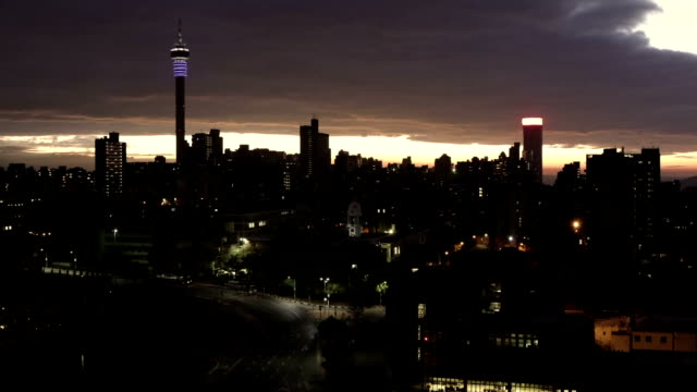 Johannesburg sunrise cityscape timeline Johannesburg cityscape timeline showing the cloudscape at sunrise, showing the Council Chamber on the left which is set to be the centre for the revitalisation and urban renewal of the precinct. Hillbrow residential area and the prominent communications tower and Ponte flats. south africa stock videos & royalty-free footage