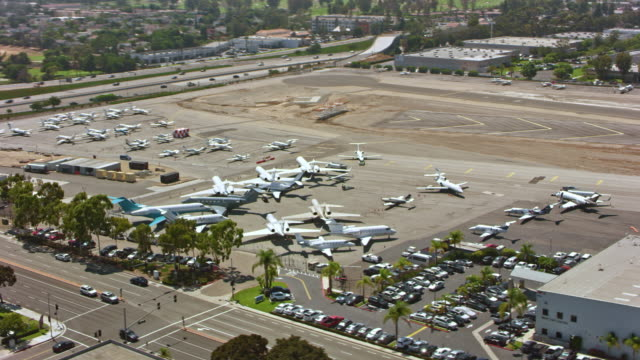 AERIAL John Wayne Airport Aerial shot of the John Wayne Airport in Orange County, California. Shot in USA. stationary stock videos & royalty-free footage