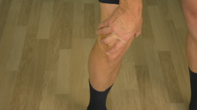 Joints pain of mans legs close up. video