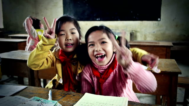 Jolly Chinese school Children Jolly Chinese school Children making victory sign. Slow motion.,,,,,, poverty stock videos & royalty-free footage