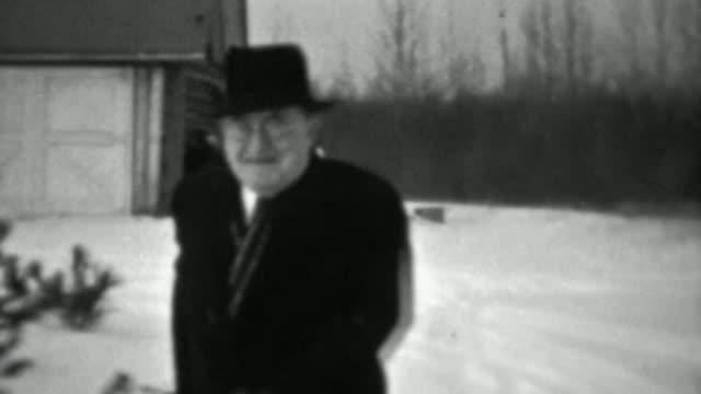 1937: Jolly old man slipping on ice winter cold weather almost falls.
