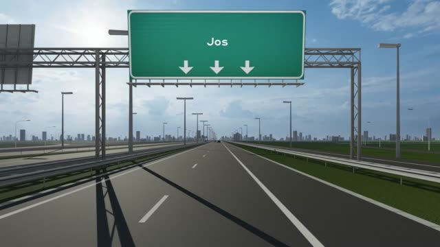 jos city signboard on the highway conceptual stock video indicating the entrance to city - jos nigeria video stock e b–roll