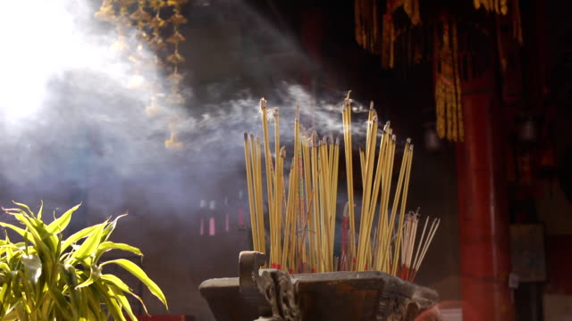 Joss sticks burn at a Chinese temple Concept of chinese offering ritual.  buddhism stock videos & royalty-free footage