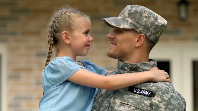 Joyful daughter looking at father military uniform, soldier homecoming, patriot Joyful daughter looking at father military uniform, soldier homecoming, patriot veteran stock videos & royalty-free footage