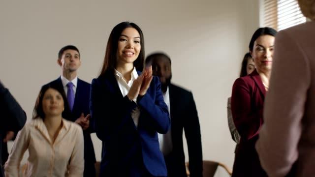 joyful diverse employees welcome executive manager - pojęcia i zagadnienia filmów i materiałów b-roll