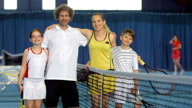 MS Joyful Family Playing Indoor Tennis video