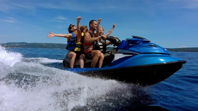 SLO MO Joyful Family Riding A Jet Boat