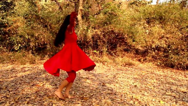 Joyful girl twirling in the nature
