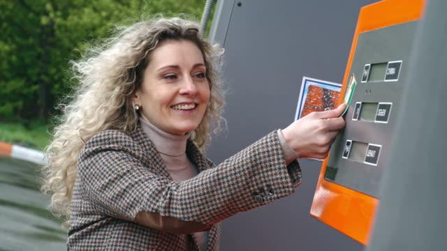 Joyful woman driver paying video