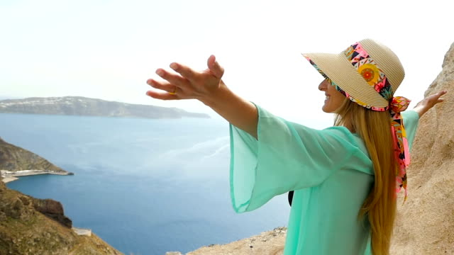 Joyful woman & vacations in Santorini