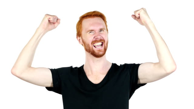 Joyful young man gesturing ,happiness ,success, good news ,white background video